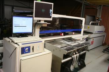 Robot de pose CMS EP600 Europlacer. Permet la fabrication de cartes électroniques CMS. Pose environ 4000 composants / heure.